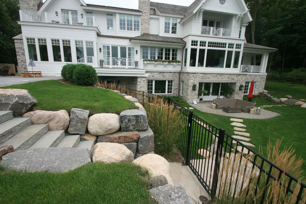 Lake Minnetoka New Home Construction Boulder Retaining Wall and Bluestone Steps to the Pool in Wayzata, Minnesota