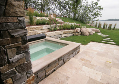 Custom Concrete Spa with Limestone Surround on a Travertine Patio