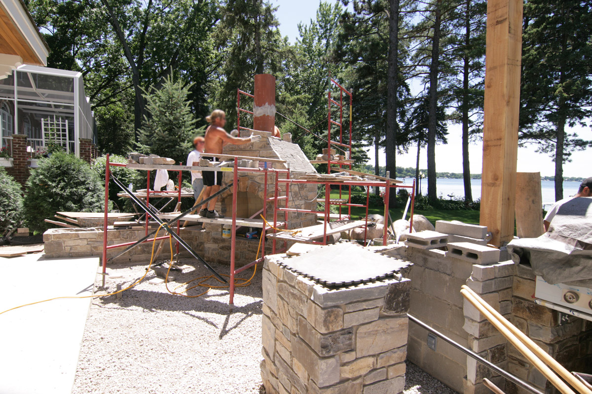 Lake-Minnetonka-home-installing-the-mortared-stone-to-fireplace