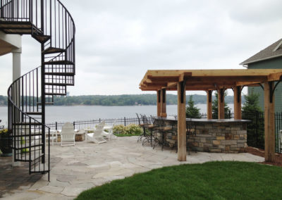 Outdoor Bar and Entertaining Space Overlooking Prior Lake, MN with Custom Cedar Pergola