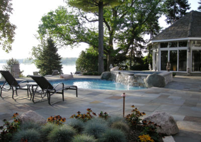 Custom Concrete Swimming Pool with Spa and Water Feature Overlooking Lake Minnetonka