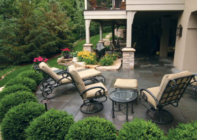 Bluestone Patio, Limestone Retaining Wall, and Basalt Stone Water Feature