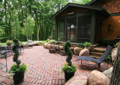 Wooded Lot with Sunken Cobblestone Paver in Herringbone Pattern