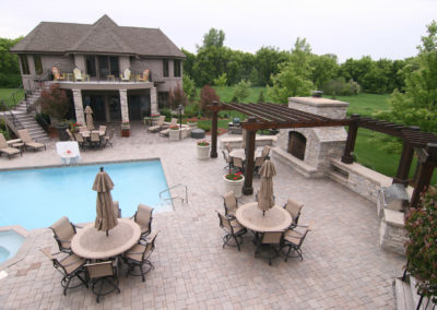 Large Paver Patio with a Limestone Fireplace, Grill and Prep Area