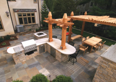 Limestone Mortared Outdoor Kitchen, Pizza Oven, Cedar Arbor on Bluestone Patio in St. Paul, MN