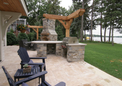 Limestone Outdoor Kitchen and Fireplace Overlooking Lake Minnetonka