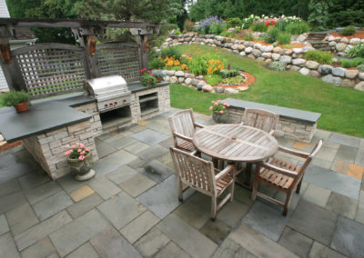Bloomington, MN Outdoor Limestone and Bluestone Kitchen with Boulder Retaining Walls