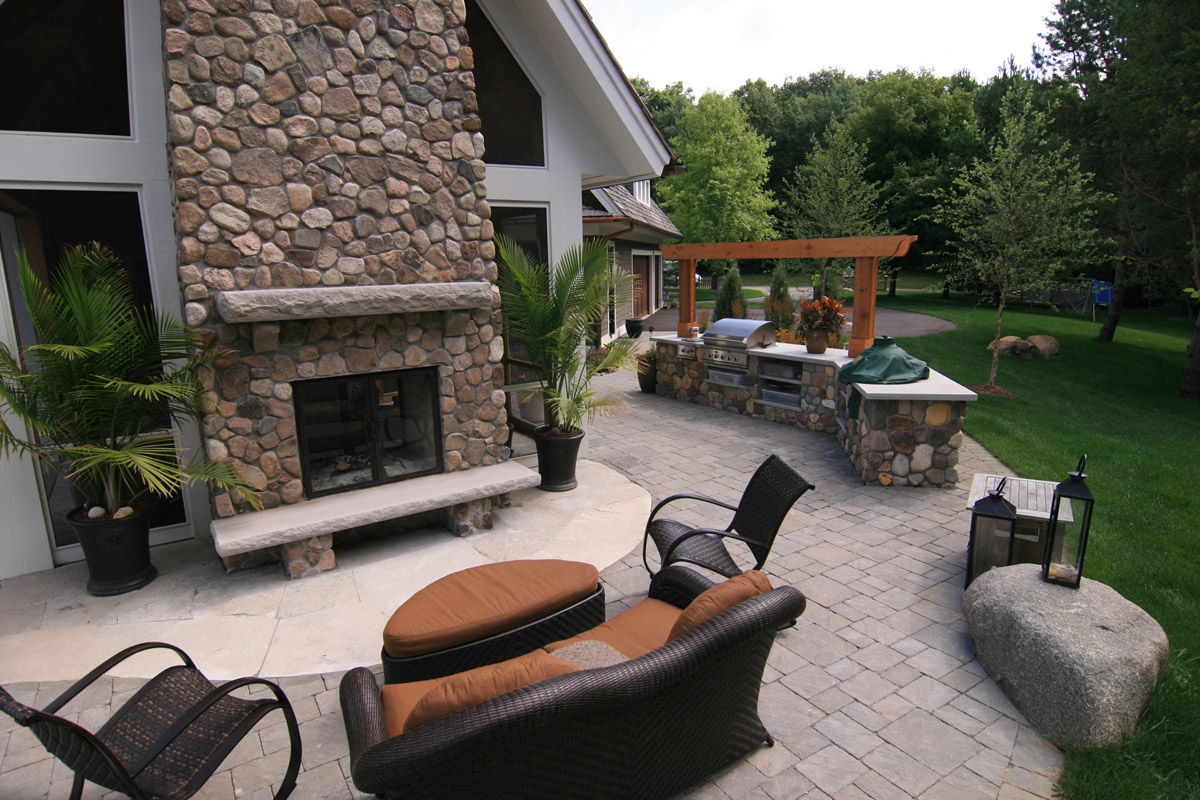 Outdoor Kitchen and River Rock Fireplace in Orono, MN