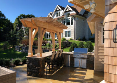Granite and Limestone Outdoor Kitchen with Cedar Pergola