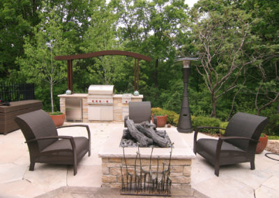 Limestone Outdoor Kitchen with Custom Metal Arbor and Downlights