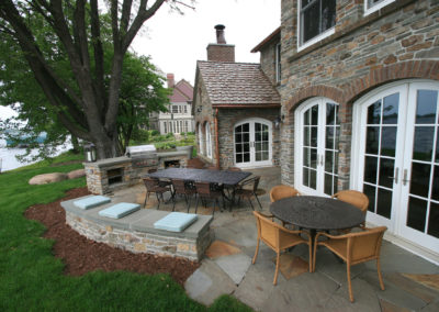Irish Cottage on Lake Minnetonka with Mortared Stone Outdoor Kitchen and Bench