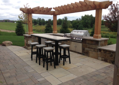 Kitchen in the Country with Limestone Park and Outdoor Kitchen