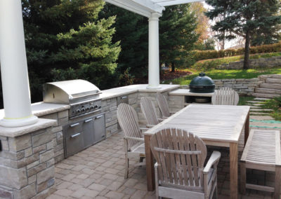 Large Limestone Entertaining Outdoor Kitchen with Grill, Refrigerator, Trash, and Pergola