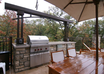 Limestone Outdoor Kitchen with Custom Metal Pergola and Downlights