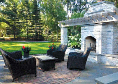 Bluestone and Paver Combo Patio with Mortared Limestone Fireplace and Arbor