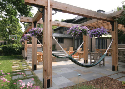 Bluestone Patio with Custom Arbor with Metal Details and Hammocks in Minneapolis, MN