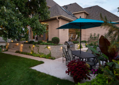 Indoor and Outdoor Entertaining on Travertine Patio and Limestone Walls