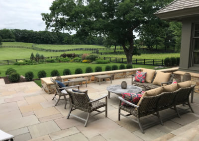 Travertine Patio and Limestone Mortared Wall for Additional Seating in Farmington, MN