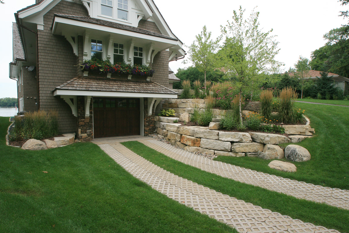 Permeable Paver Driveway with Limestone Retaining Walls and Boulder Outcroppings
