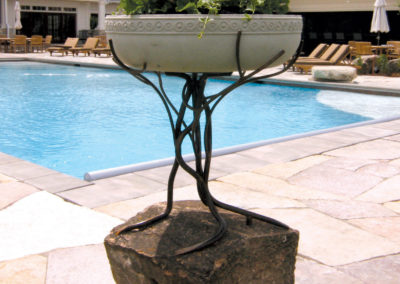 Custom Steel and Stone Holding a Limestone Planter
