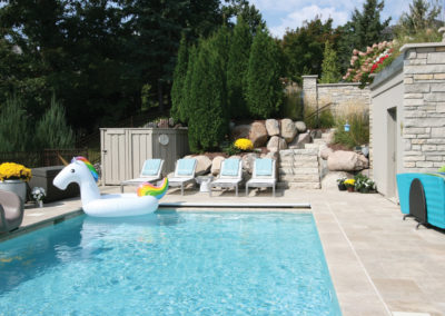 Custom Concrete Swimming Pool with Travertine Surround