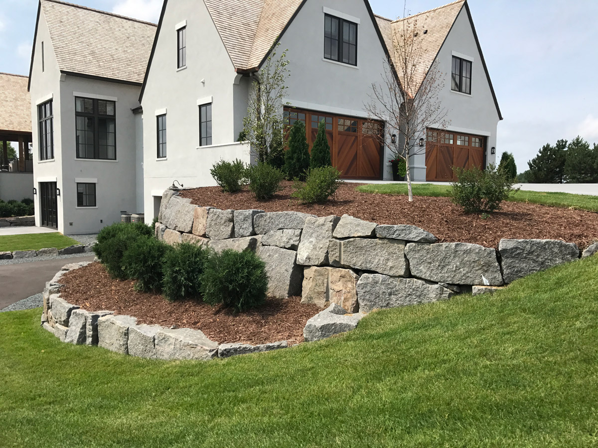 Contemporary Home with Clean Granite Boulders and Minimal Plantings