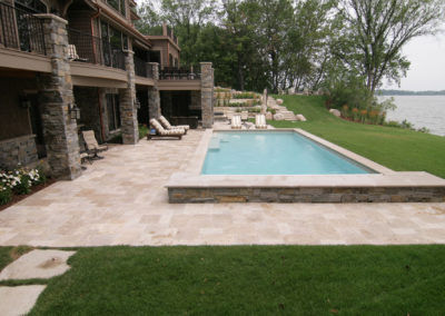 Custom Concrete Swimming Pool Partially in Ground for Extra Seating