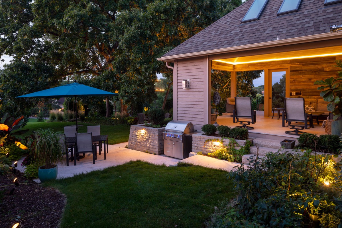 Low Voltage Lighting showing the Screen Porch, OUtdoor Kitchen and Patio in Eden Prairie, MN