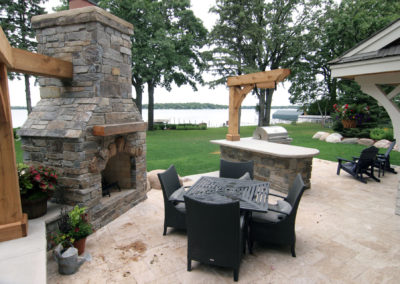 Granite Mortared Fireplace and Outdoor Kitchen and Travertine Patio