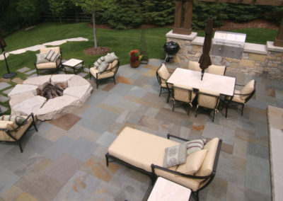 Limestone Slab Fire Pit, Bluestone Patio, and Limestone Outdoor Kitchen