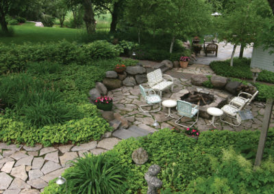 Flagstone Fire Pit, Boulder Retaining Wall, Flagstone Patio, and Granit Steps