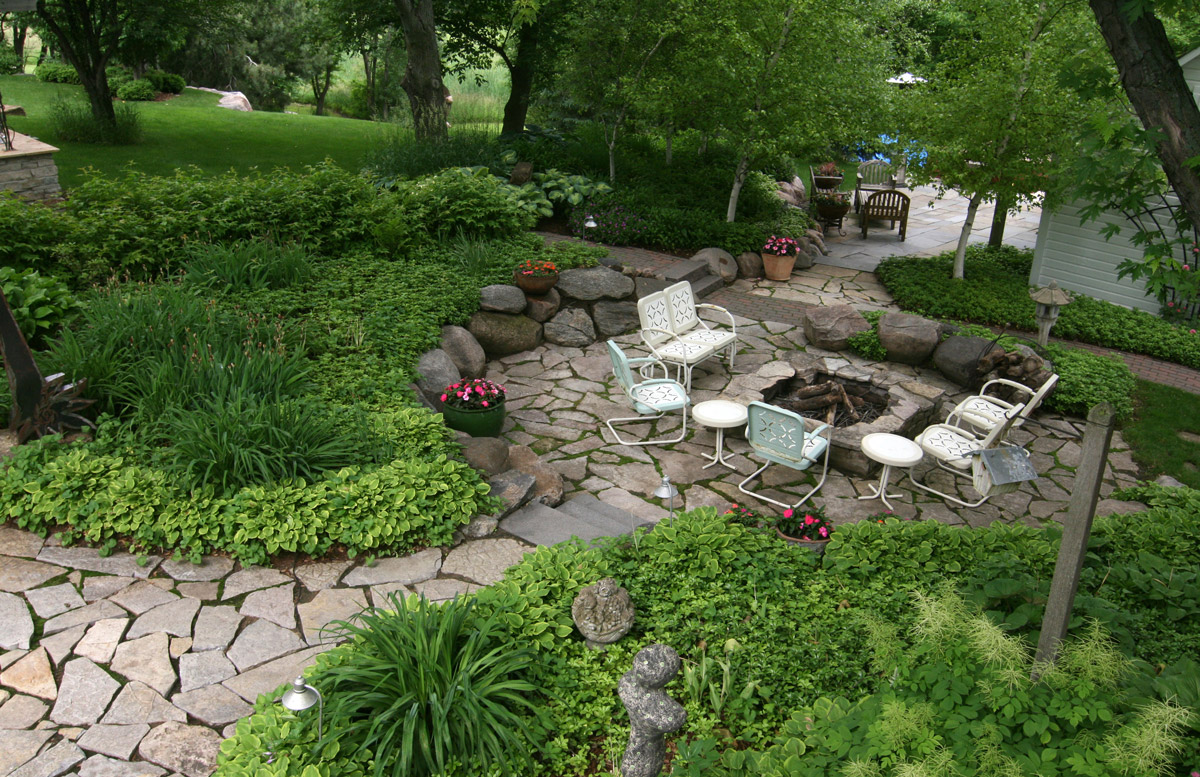 Woodburning-Fire-Feature-with-Gardens-and-Flagstone-Patio