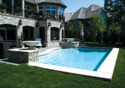 Custom Concrete Dipping Pool with Water Features and Bluestone Patio