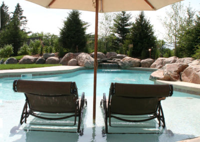 Custom Concrete Pool with Sundeck and Water Feature