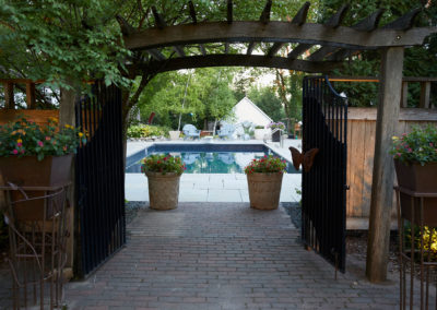 Existing Gates and Paver Entry Leading on to a new Travertine Patio Vinyl Pool